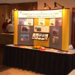 CP2 booth stands ready as Karl Myers, Windsor Fuel Company and Joe Platt, SEM Materials, talk in the background.