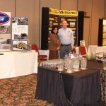 Vendor booths and discussions in the tradeshow area